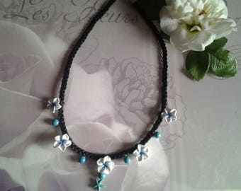 Flower tiara and pearls necklace