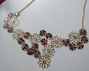Jewel flower gilded and varnished with fall colors necklace.