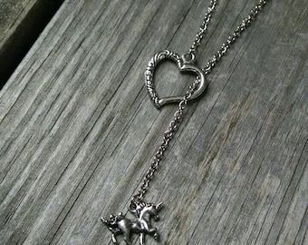 Unicorn and heart pull necklace