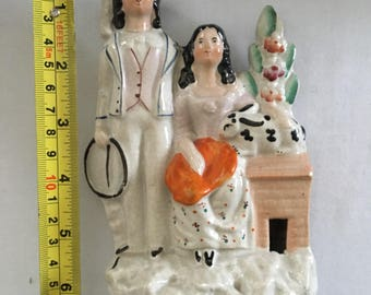 Staffordshire group nicely painted couple with rabbit made in or around 1860