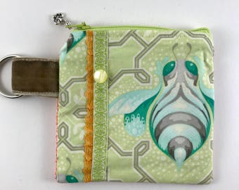One of a kind vintage inspired fabric coin purse or pouch. Vintage button adornment.