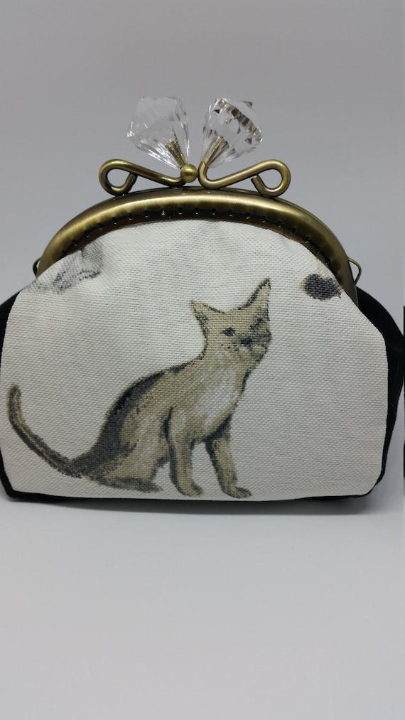 CP578.    The cat coin purse.