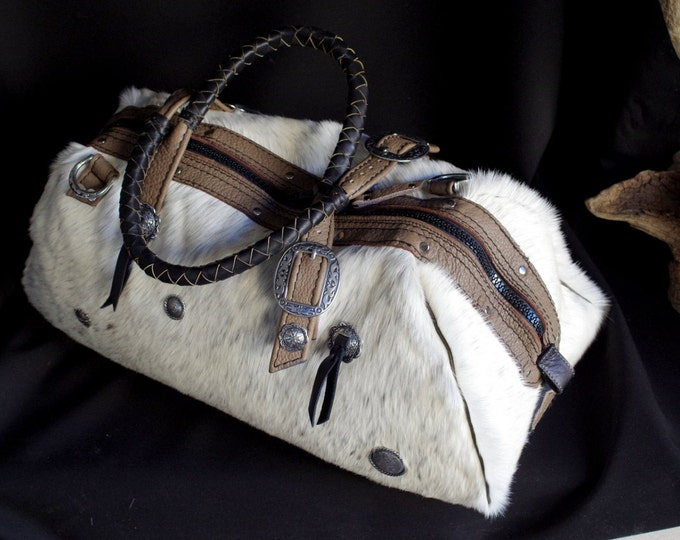 handbag, travel bag, leather and western inspired decorative conchos
