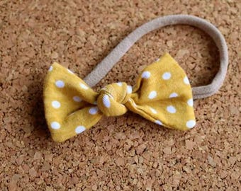 Mustard yellow polka dot knotted bow