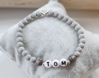 Name Bracelet black and white child daughter desire female girl name male man person personal name