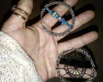 Hoop earrings. Roman numeral eyecatchers