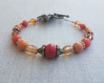 Orange Bracelet with Copper and Brass Colored Accents with a Toggle Flower Clasp, Jewelry