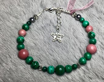 Great bracelet being natural stones of malachite and Rhodonite beads.