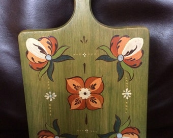 Vintage handpainted Rosemaling on wood cutting board by Brenda's in Michigan.