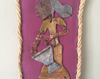 Recycled metal and fabric Haitian art