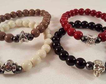 Enchanting filigree beaded bracelets made of acrylic beads, hematite and 4 different motif beads