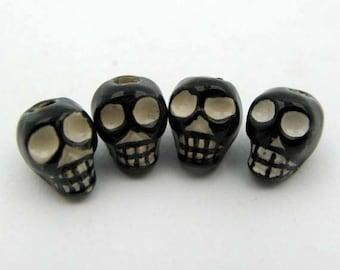 10 Black Skull Beads - vertical