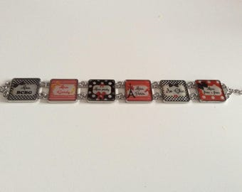 Red, black, yellow and white square cabochon bracelet.