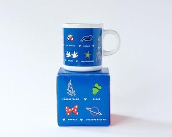 Vintage 1990's Disneyland Paris souvenir miniature blue mug.  Fantasyland, Discoveryland, Frontierland, Main street, Adventureland mug.