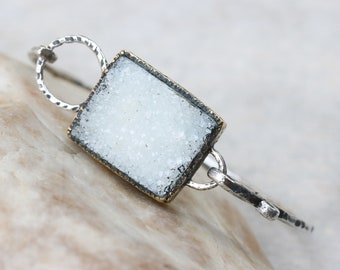 Light gray ractangle druzy bracelet in brass bezel setting on oxidized sterling silver with texture band