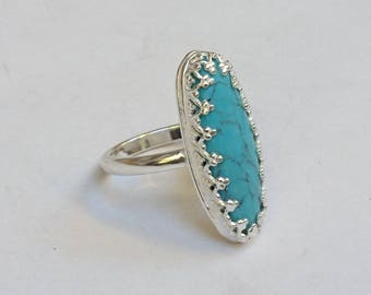 Sterling silver marquise turquoise ring, hallmarked in Edinburgh.