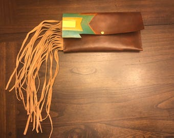 Hand tooled leather clutch with fringe
