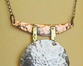 A Unique Handhammered German Silver Moon Pendant