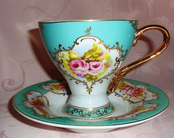 Nantucket Home Footed Teacup & Saucer - Ornate Aqua and White with Pink Roses and Gold Detail