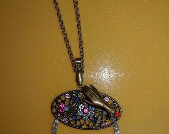 Eyeglass holder pendant.
