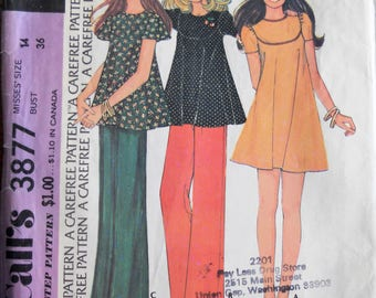 McCall's 3877.  Vintage 1973 Boho top and bell bottom pants pattern.   Mini dress pattern.  Bell bottom pants pattern.  1973 fashion. Sz 14.