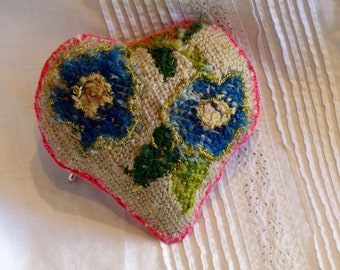 Heart brooch tapestry upcycled.