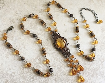 Long Deco Style Pendant Necklace Topaz Glass and Antique Brass