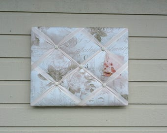 French Memory Board, White and pale pink cotton fabric over a solid wood frame, batting, satin and organza ribbon with floral cabochons