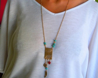 "Handmade necklace was golden bronze with natural turquoise stones and carnelian ""Haïku"" collection."