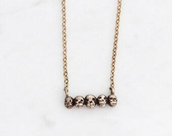 Tiny golden skull necklace