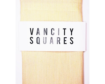 Mens yellow pocket square with white striped print, with custom thread.