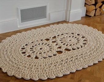 Crocheted natural white oval rug
