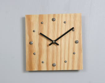 Plywood clock with stainless steel hour markers and Tung oil finish.  USPS priority shipping to USA included