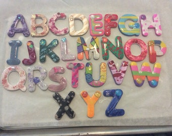 Fully magnetic wooden hand painted ABCs