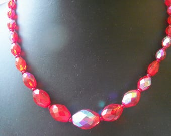 Gorgeous iridescent scarlet faceted glass bead necklace with claw set AB clasp