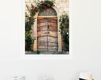 Print - French prints - An old wooden door framed by roses leads to a Stone house, France - Wall Art