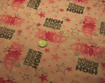 1 yard and 32 inches pink,  High School Musical cotton flannel fabric.    ....new never used...