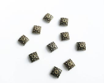 Bronze metal caps