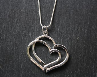Twin heart silver pendant