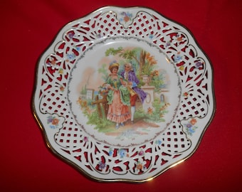 "One (1), 10 1/2"", Porcelain, Pierced Lattice Rim, Dinner Plate, by CICO (Germany US Zone), in the CIQ19 Pattern."