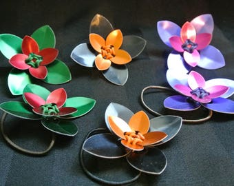 scale flower broaches and hair elastics