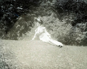 vintage photo WOman Wears Big Hat Lays Across Grass 1909