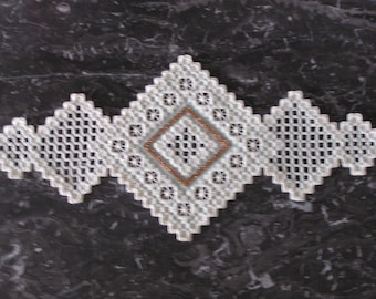Green and ecru Hardanger embroidery doily