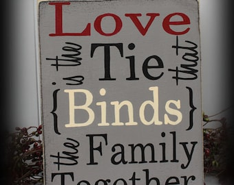 Love Is The Tie That Binds The Family Together Sign