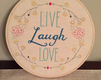 """Ready to Hang Embroidered Wall Hanging """"Live Laugh Love"""""""