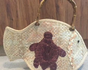 Cayman Silver Thatch Fish Handbag with Turtle stitched on.