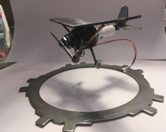 Metal airplane sculpture