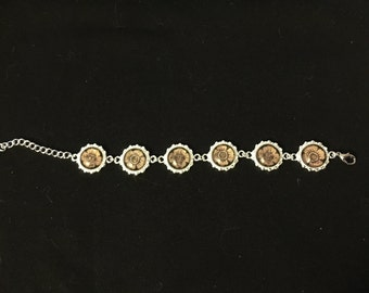 Silver plated bracelet with gold flower center
