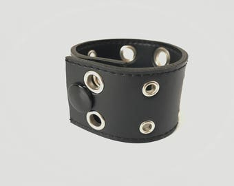 Black leather cuff bracelet with silver eyelets by Freedom & Faith Co