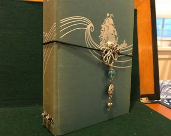 Traveler's notebook made from a vintage copy of Botany Bay by Charles Nordhoff and James Norman Hall.